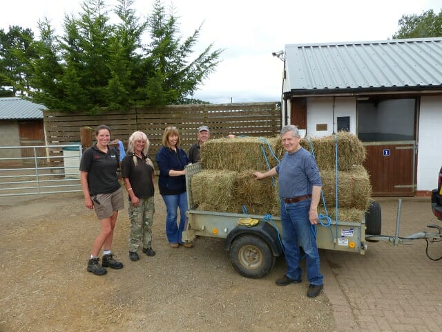 Staff at Redwings Horse Sanctuary with Sun Rising Volunteer Robin dropping off the Hay Bales