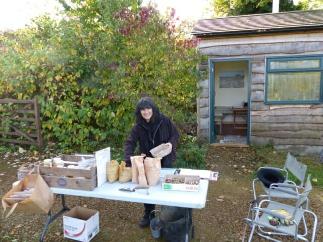 Emma Restall Orr sorting Bulbs for Planting Day at Sun Rising Natural Burial Ground and Nature Reserve