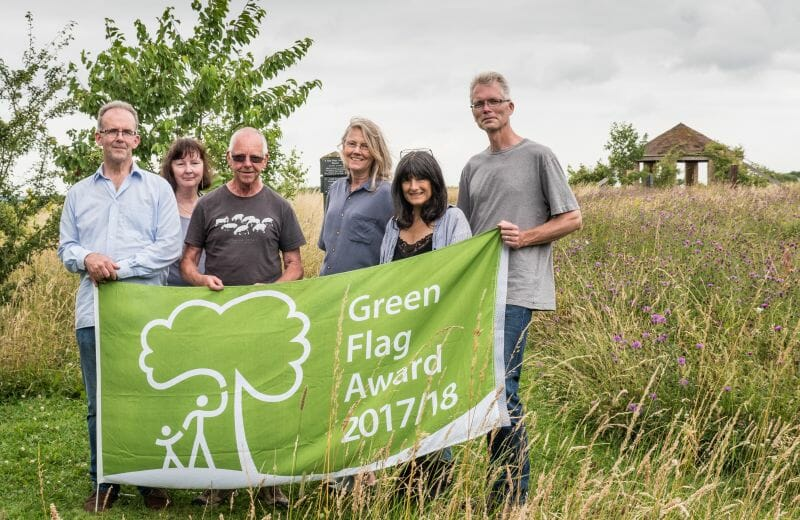 Emma and David with Friends and Volunteers with Green Flag at Sun Rising