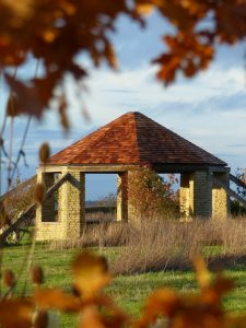 The Roundhouse through Autumn leaves at Sun Rising.