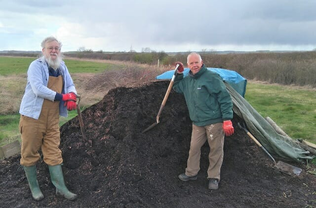 Composted Bark Heap with Volunteers Hard at Work!